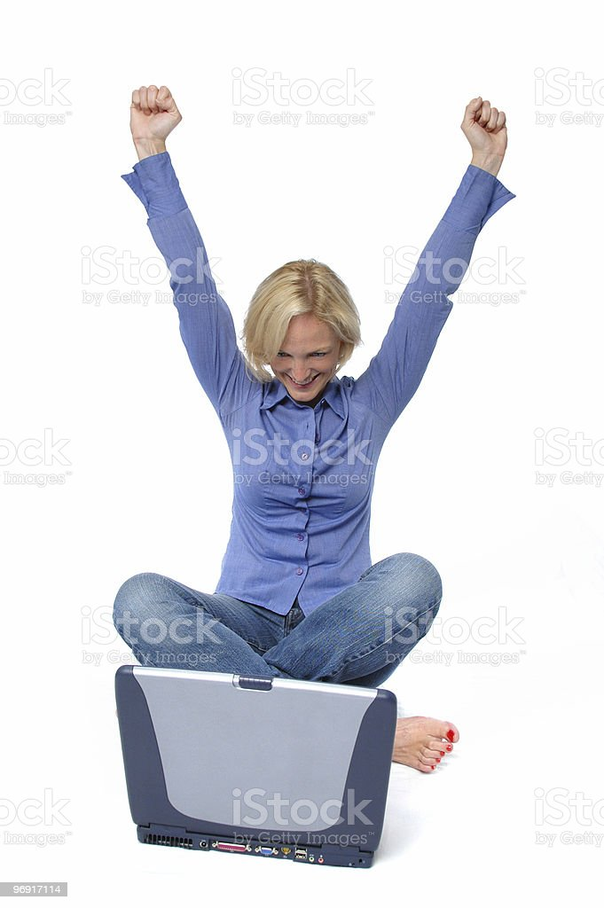 Attractive excited  blond with laptop royalty-free stock photo