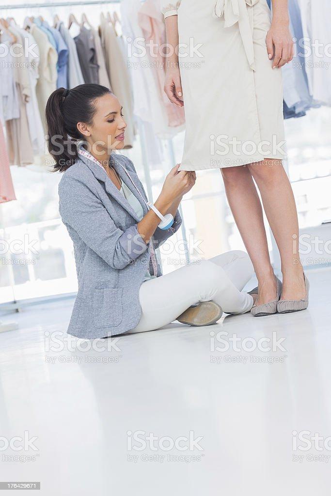 Attractive fashion designer sitting next to a model stock photo