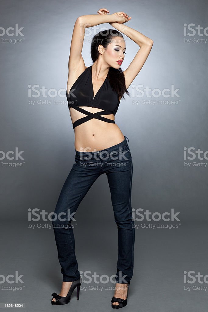 Attractive fashion model in skinny jeans royalty-free stock photo