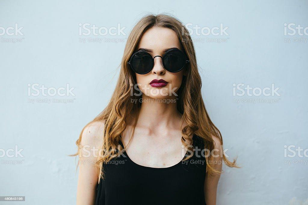 Attractive fashion woman in black dress stock photo