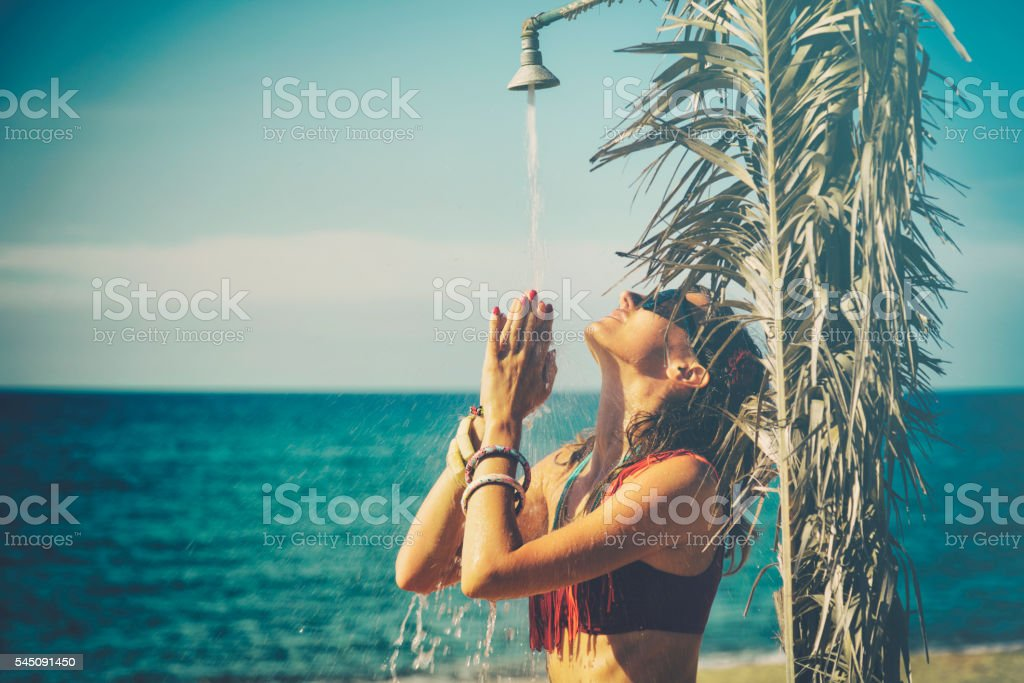 Attractive fashionable woman having fun on the beach. stock photo
