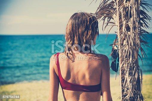 545091450istockphoto Attractive fashionable woman having fun on the beach. 579754744