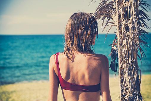545091450 istock photo Attractive fashionable woman having fun on the beach. 579754744