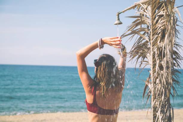 Attractive fashionable woman having fun on the beach. stock photo