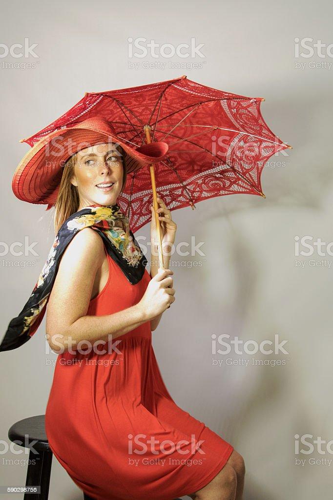 Attractive Female Adult with Parasol Sitting Outside royaltyfri bildbanksbilder