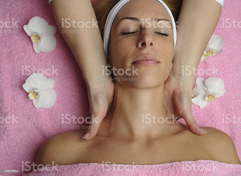 Attractive female at massage royalty-free stock photo