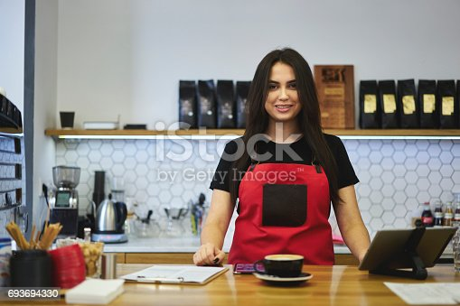 istock Attractive female businesswoman barista owner of bar caffe 693694330