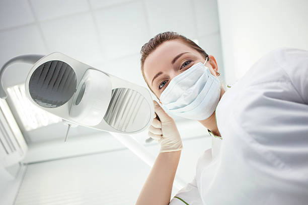 Attractive female dental doctor is working in her office stock photo