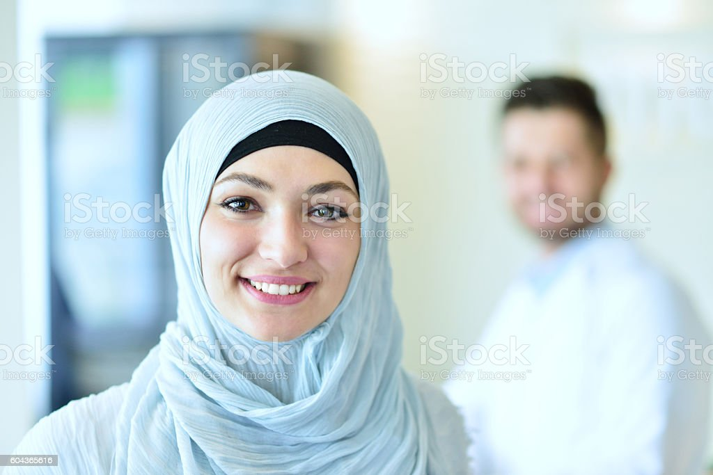 attractive female doctor in front of medical group stock photo