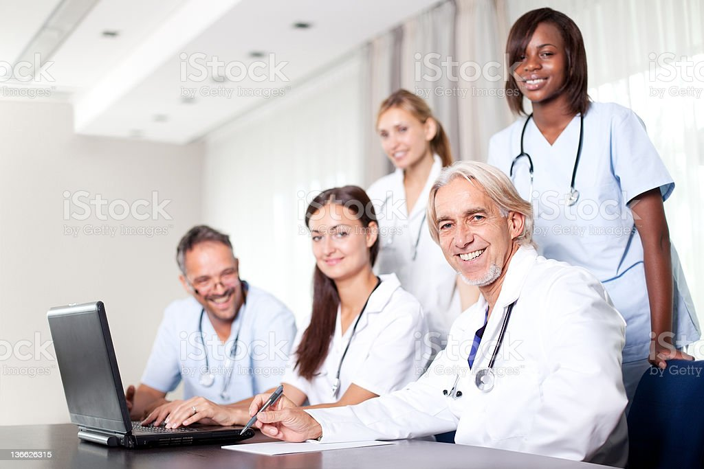 Attractive female doctor working on her laptop royalty-free stock photo