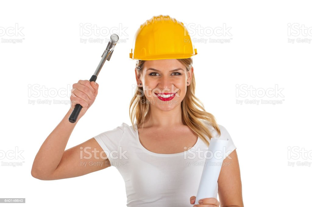 Attractive female engineer holding a hammer stock photo