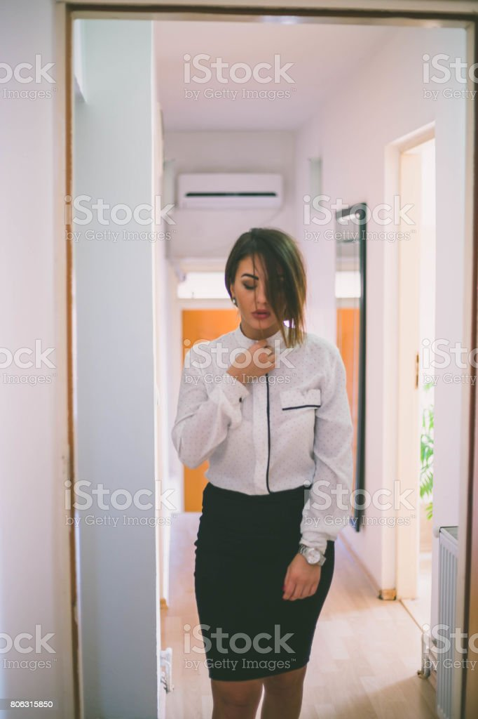 eb78ee5b2 Attractive female executive wearing shirt and mini skirt . Beautiful  caucasian female model in business attire getting ready for work. - Stock  image .