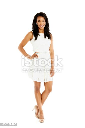 Full length portrait of attractive female fashion model posing over white background
