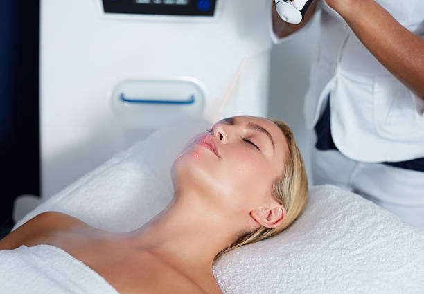 Attractive female getting local cryotherapy therapy Attractive young woman getting local cryotherapy therapy at cosmetology clinic. Applying cold nitrogen vapors to the face of woman. cryotherapy stock pictures, royalty-free photos & images