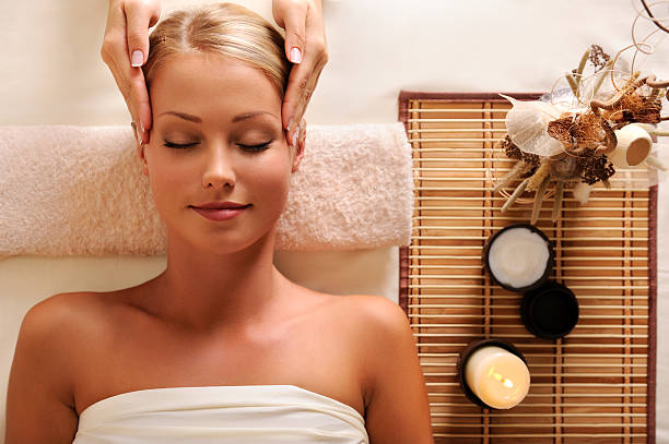 attractive female getting recreation massage of head stock photo