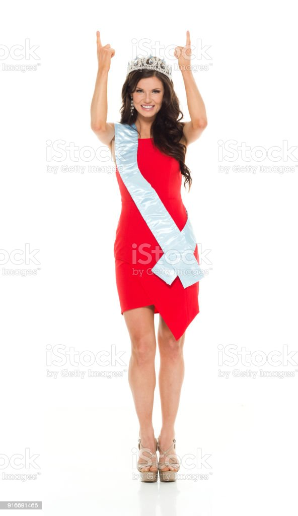 Attractive female in pageant clothing stock photo