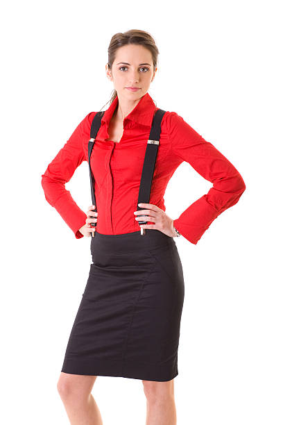 attraktive frau in roten hemd und hosenträger, isoliert auf weiss - rote bleistiftröcke stock-fotos und bilder