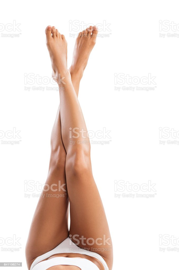 Attractive female legs isolated on white background stock photo