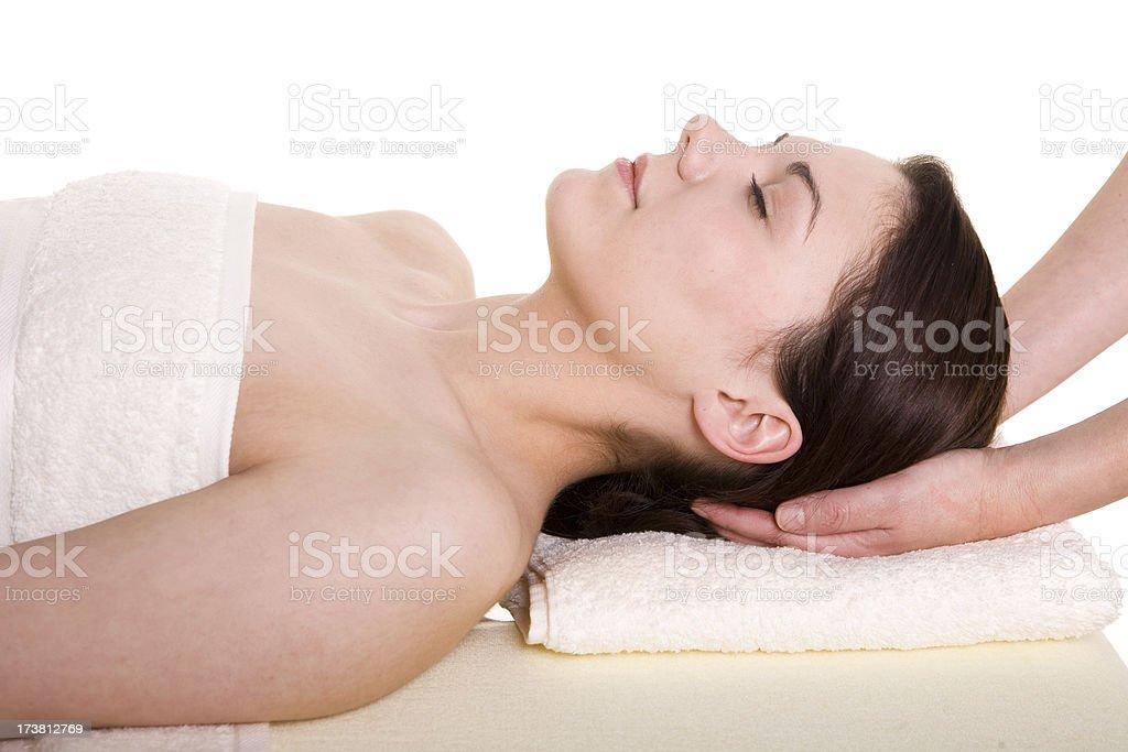 Attractive Female lying down having head massage royalty-free stock photo