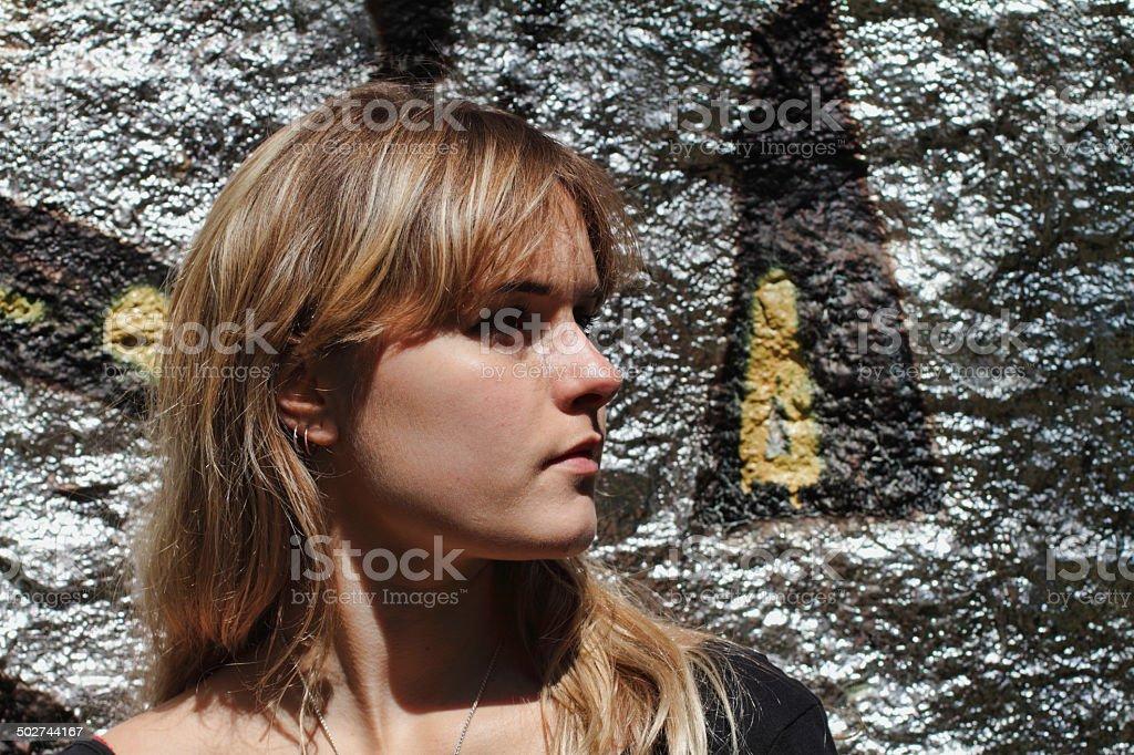 London outdoor girl profile and silver graffiti wall stock photo