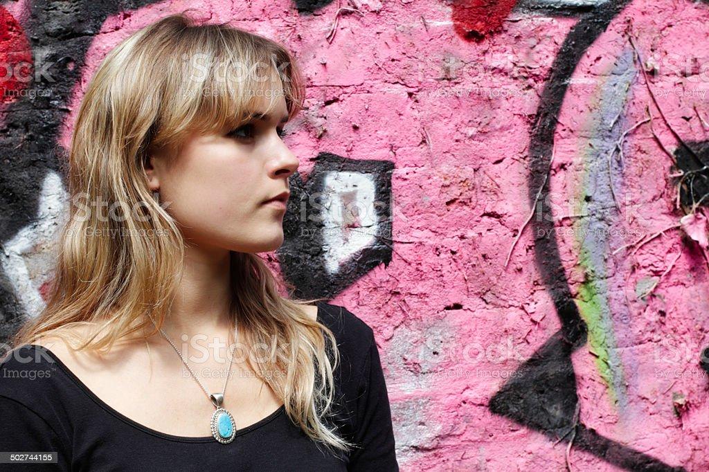 London outdoor girl profile and pink graffiti wall stock photo