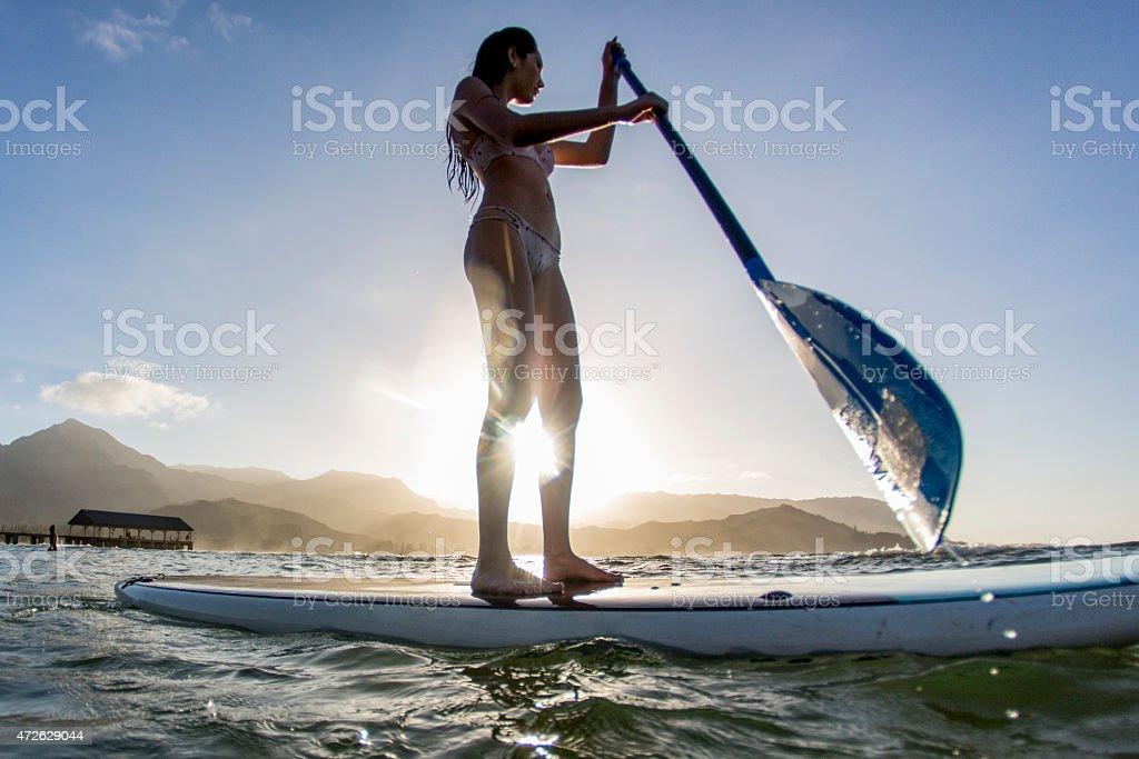 Attractive Female Paddle Boarding stock photo