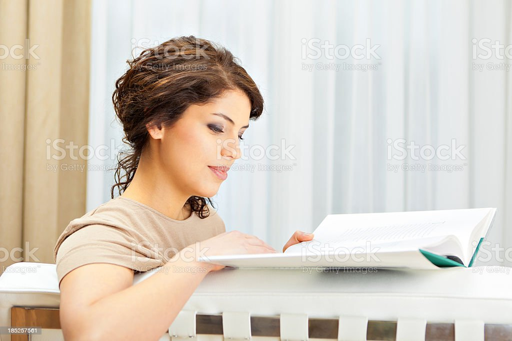 Attractive female reading at home stock photo
