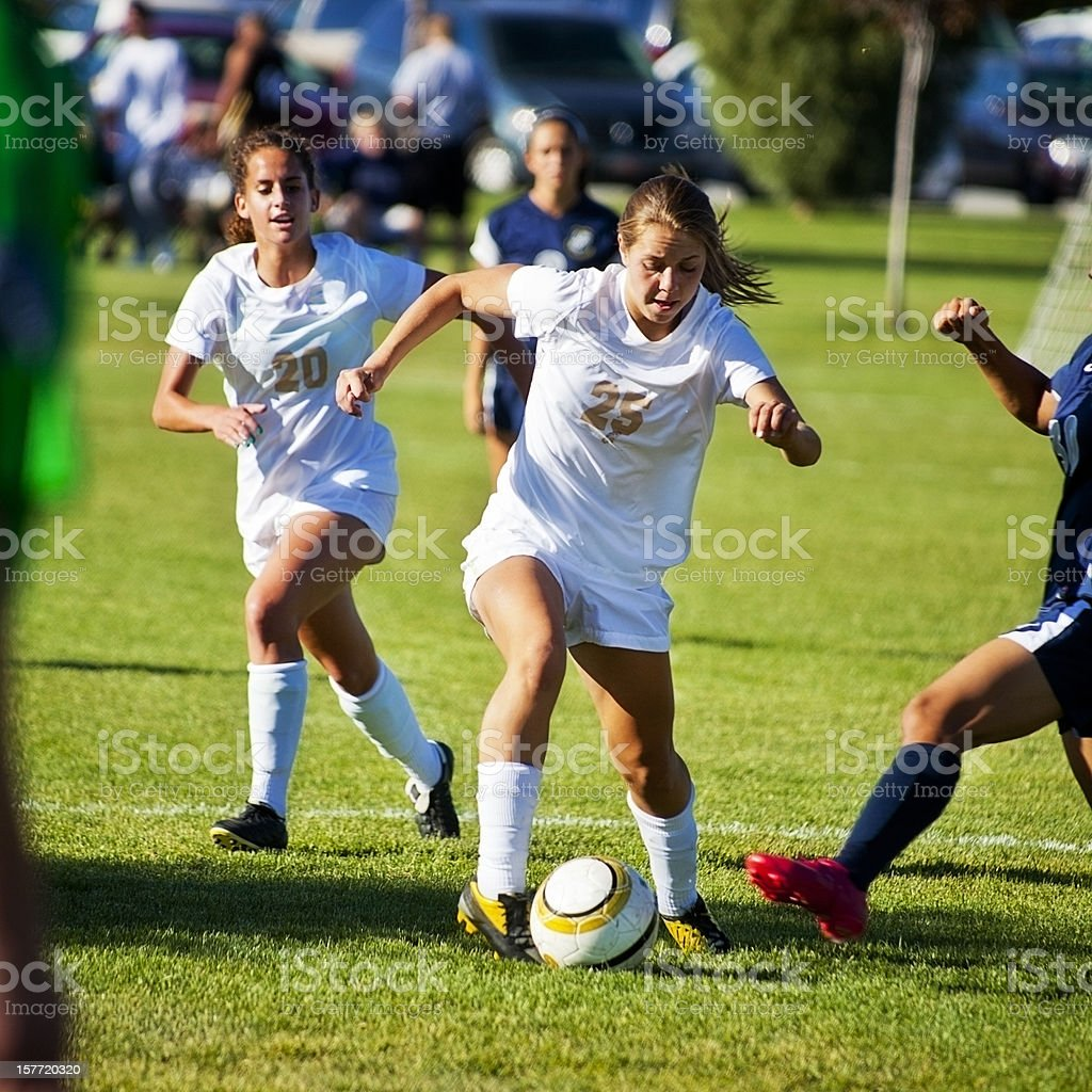 Attractive Female Soccer Players Compete for Control of Ball royalty-free stock photo