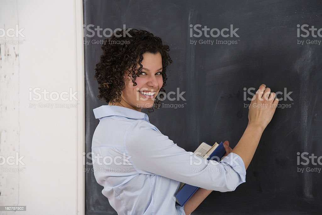 Attractive Female Teacher or Student at the Chalkboard royalty-free stock photo