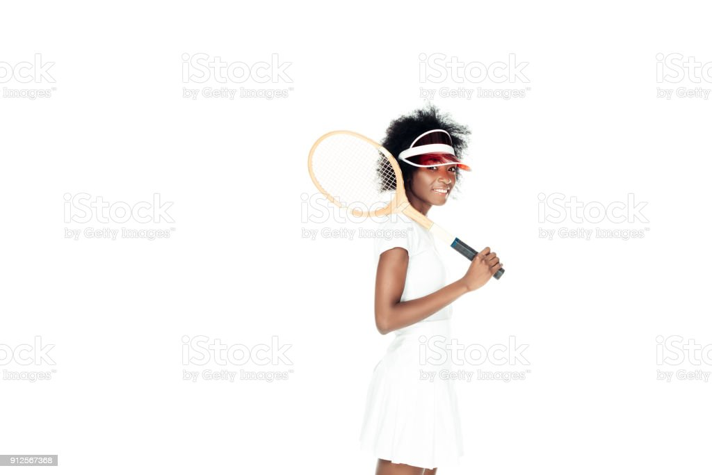 attractive female tennis player with racket isolated on white stock photo