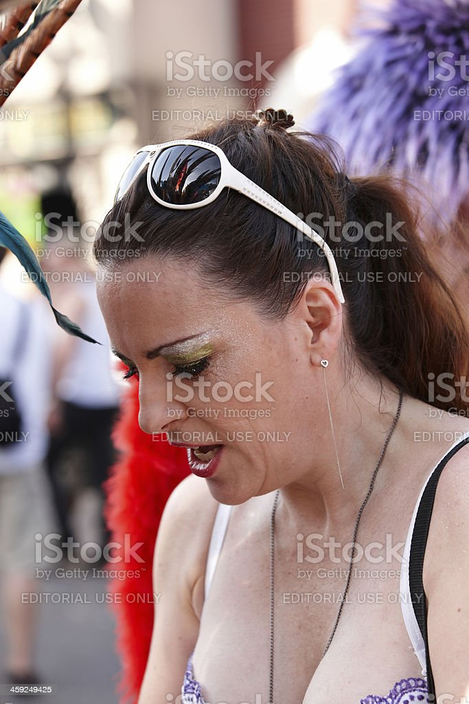 Attractive female Toronto gay pride parade reveller in the crowd royalty-free stock photo