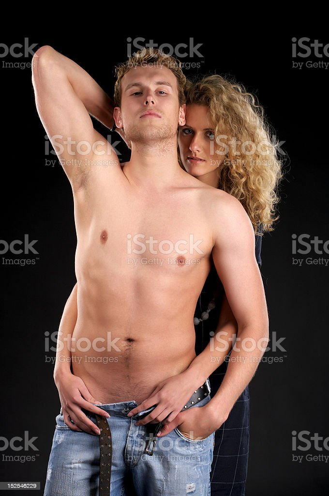 Attractive female undressing man royalty-free stock photo