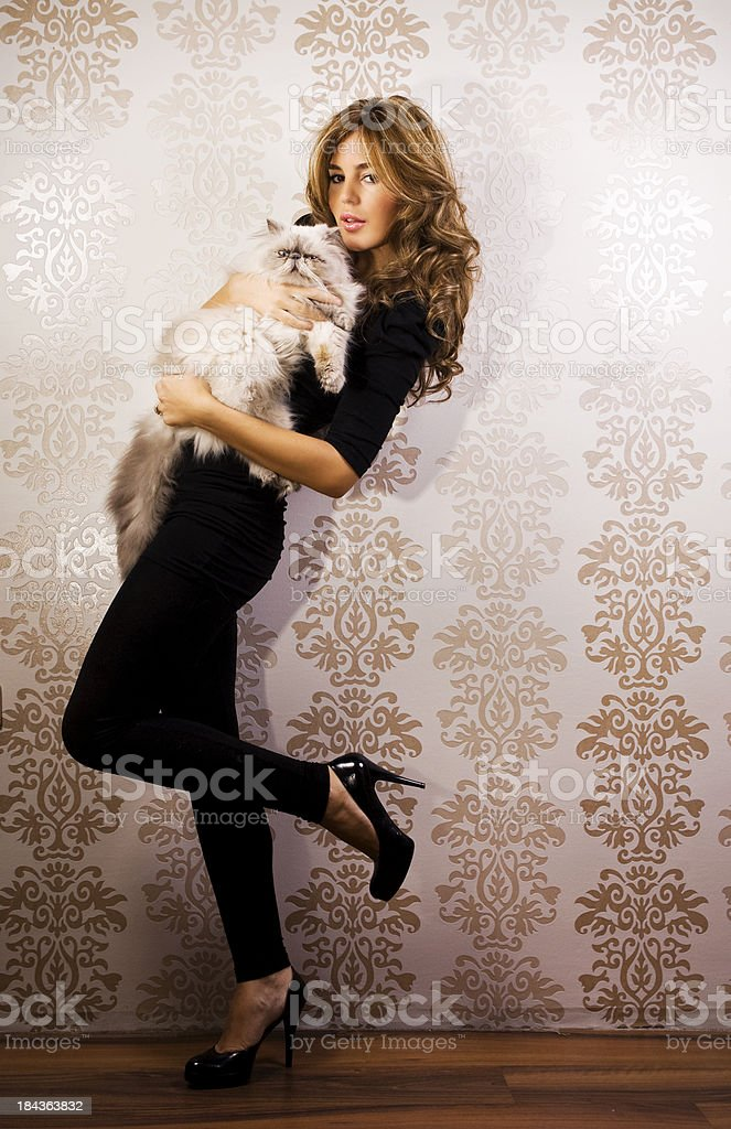 Attractive female with persian cat royalty-free stock photo