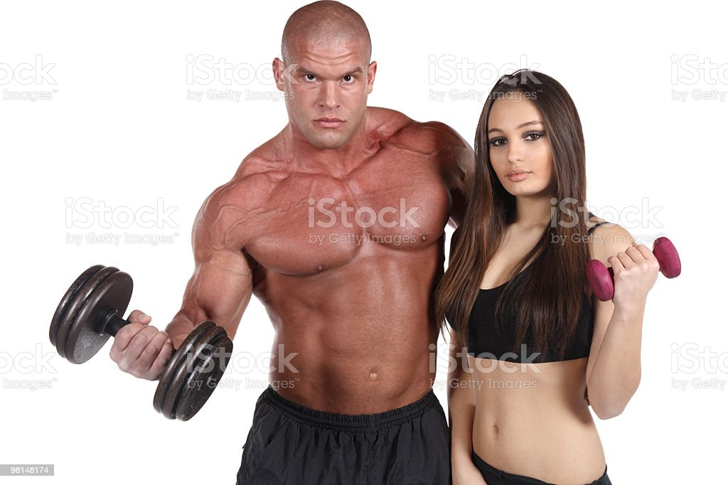 Attractive fitness couple exercising stock photo