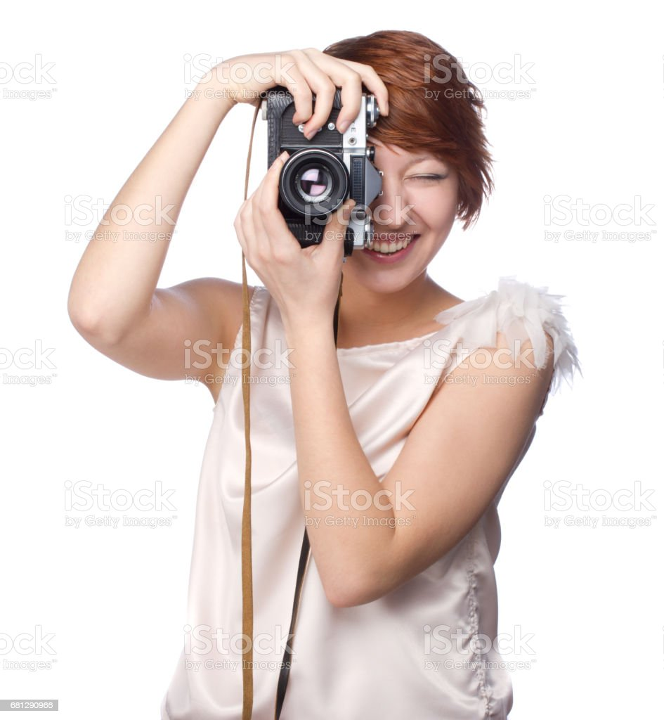 Attractive funny girl with a camera over white royalty-free stock photo