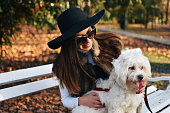 istock Attractive Girl and White Puppy 1203623429