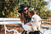 istock Attractive Girl and White Puppy 1203623490