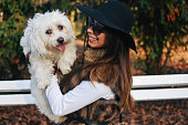istock Attractive Girl and White Puppy 1203623742