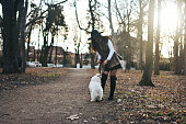 istock Attractive Girl and White Puppy 1203624820