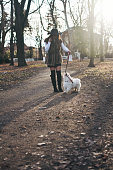 istock Attractive Girl and White Puppy 1203625082