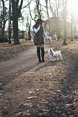 istock Attractive Girl and White Puppy 1203626521