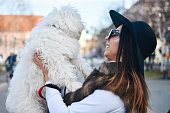 istock Attractive Girl and White Puppy 1203627536
