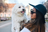 istock Attractive Girl and White Puppy 1203627610