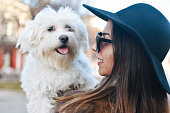 istock Attractive Girl and White Puppy 1203627646