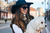 istock Attractive Girl and White Puppy 1203627693