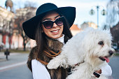 istock Attractive Girl and White Puppy 1203627774