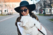 istock Attractive Girl and White Puppy 1203628152