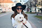 istock Attractive Girl and White Puppy 1203628153