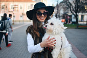 istock Attractive Girl and White Puppy 1203628167
