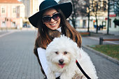 istock Attractive Girl and White Puppy 1203629267